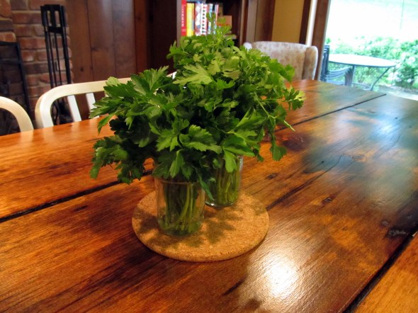 you can store your fresh cut herbs in jars of water, just like flowers, until ready to use or dry (and they kind of make a nice centerpiece for your table).