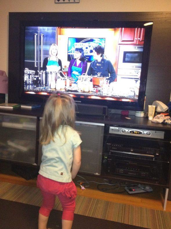 Viv watching Sara on TV